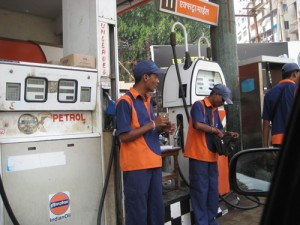 There is a constant queue for petrol and these boys will sell it by the pop bottle.