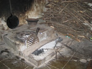 Many villagers cook over an open fire like this one