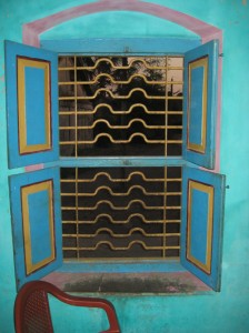 All windows have shutters but no glass. The metal bars keep out intruders but not the mosquitoes!